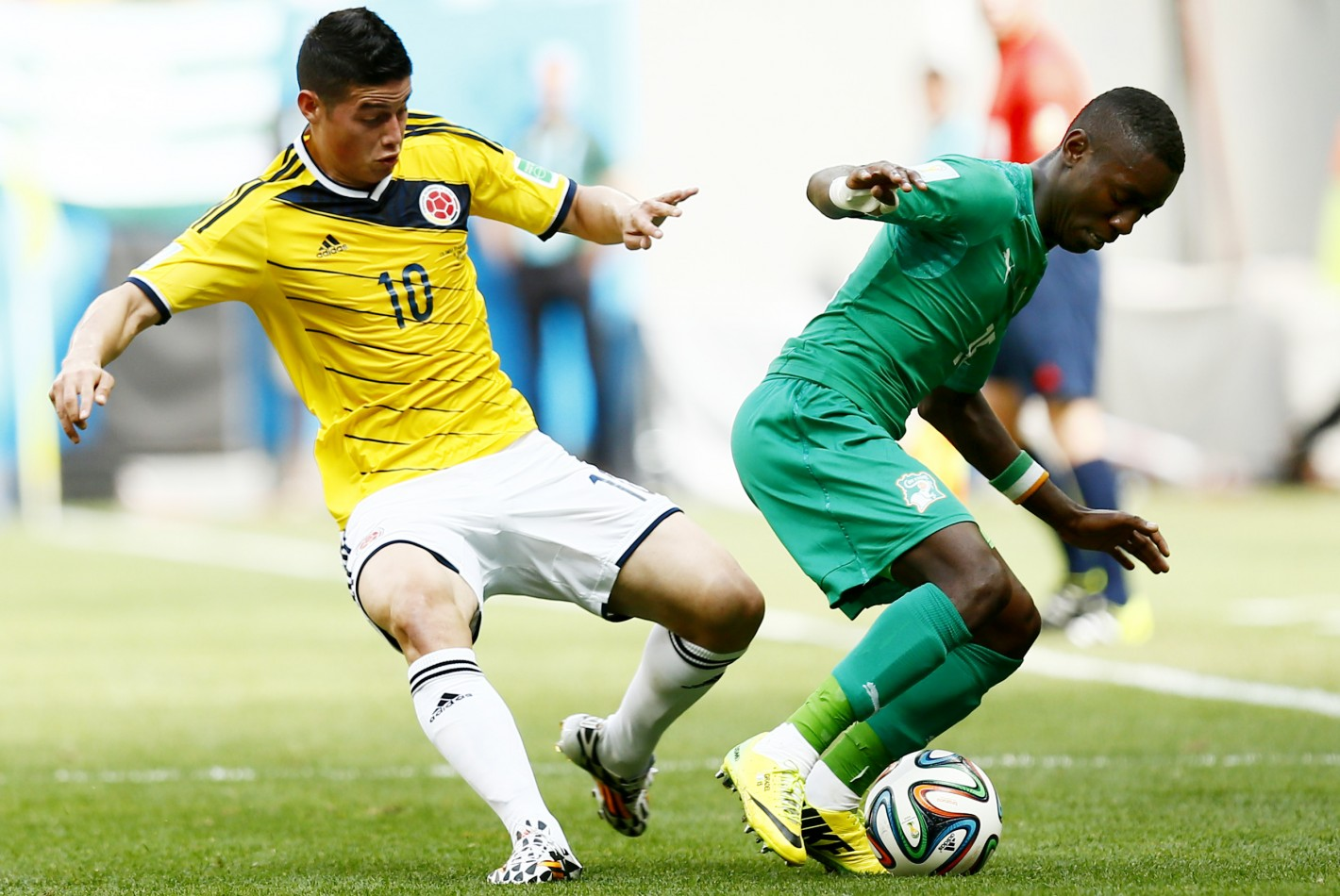 Football - Colombia v Ivory Coast - FIFA World Cup Brazil 2014 - Group C - Estadio Nacional, Brasilia, Brazil - 19/6/14 Colombia's James Rodriguez in action with Ivory Coast's Max Gradel (R) Mandatory Credit: Action Images / Jason Cairnduff Livepic EDITORIAL USE ONLY.