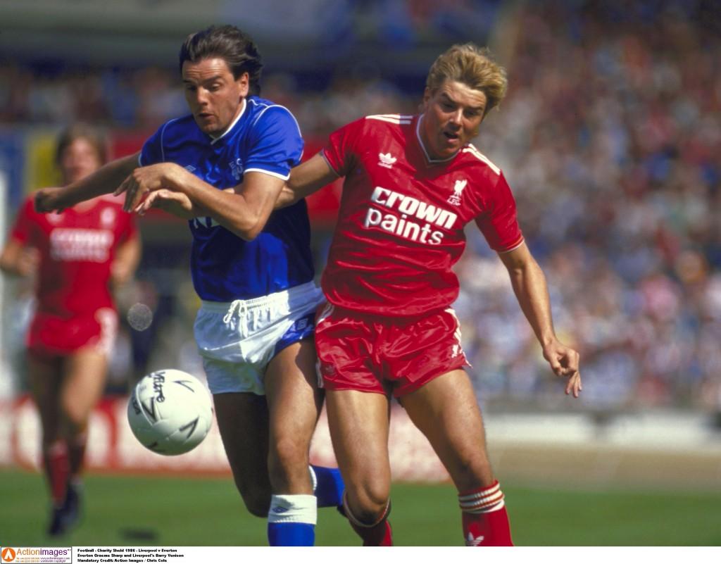Everton Graeme Sharp's tussles with Liverpool's Barry Venison. Action Images / Chris Cole