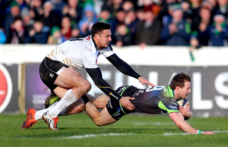 European Rugby Champions Cup Round 5, Sportsground, Galway 14/1/2017 Connacht vs Zebre Connacht's Kieran Marmion scores his sides ninth try despite Lloyd Greeff of Zebre Mandatory Credit ©INPHO/James Crombie