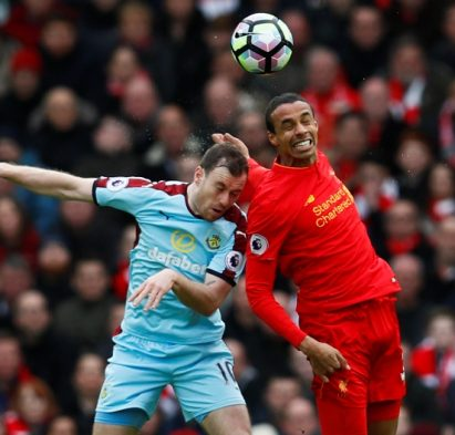 "Britain Football Soccer - Liverpool v Burnley - Premier League - Anfield - 12/3/17 Burnley's Ashley Barnes in action with Liverpool's Joel Matip  Action Images via Reuters / Jason Cairnduff Livepic EDITORIAL USE ONLY. No use with unauthorized audio, video, data, fixture lists, club/league logos or ""live"" services. Online in-match use limited to 45 images, no video emulation. No use in betting, games or single club/league/player publications.  Please contact your account representative for further details."