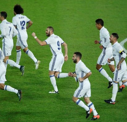 Football Soccer - Real Madrid v Kashima Antlers - FIFA Club World Cup Final - International Stadium Yokohama - Japan , 18/12/16 Real Madrid's Karim Benzema celebrates with team mates after scoring the first goal for his side Reuters / Issei Kato Livepic