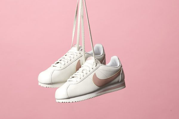 Women's White & Pink Nike Cortez Trainers