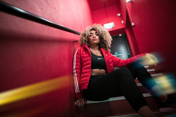 model wearing a red adidas originals puffy jacket